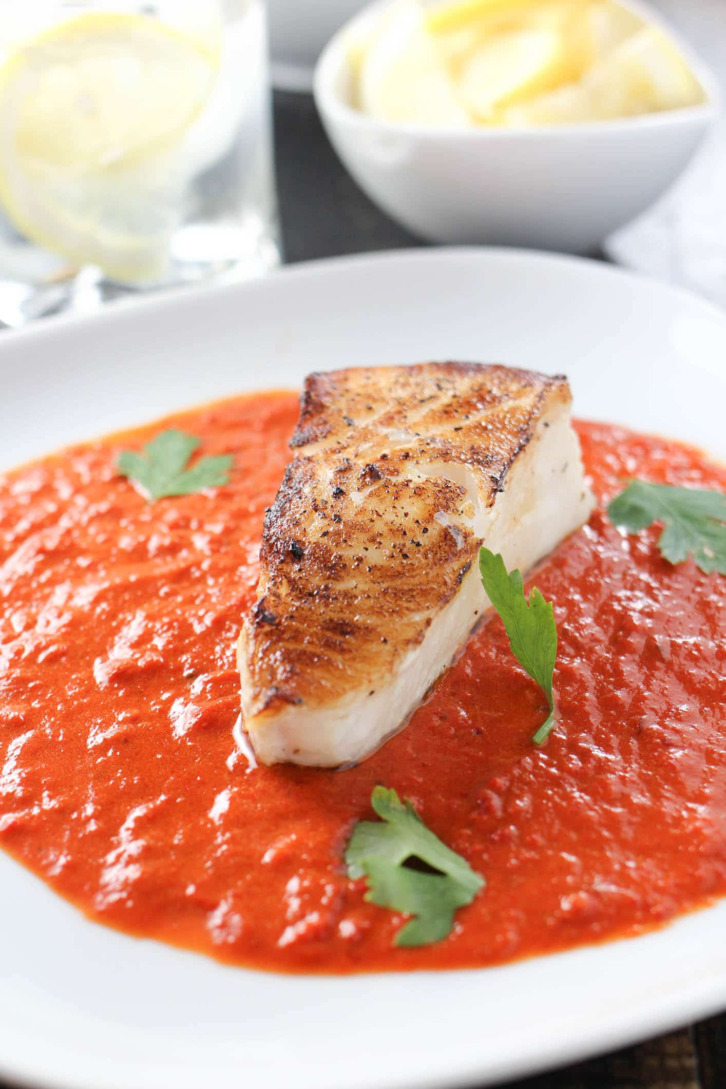 Pan Roasted Chilean Sea Bass with Roasted Red Pepper Sauce - Girl ...