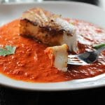 A perfectly seared Chilean sea bass with a spicy red pepper sauce.A perfectly seared Chilean sea bass with a spicy red pepper sauce.