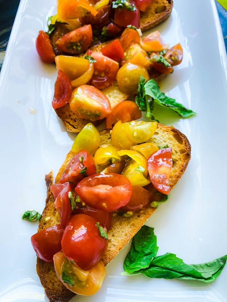 Learning how to make a classic Italian bruschetta means having the best appetizer recipe in your arsenal. It's a combination of bright and juicy tomatoes, fruity olive oil and crispy bread. It's classic, delicious and beyond simple!