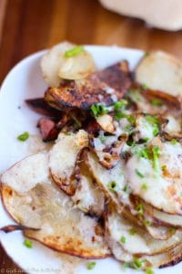 The ultimate hangover cure is thinly sliced potatoes with savory onions topped off with gooey and salty cheese. Bye bye hangover!