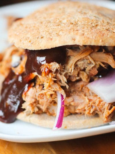 A healthy and super easy one pot crock pot pulled pork that is filled with tangy and sweet flavors and leaves all the calories behind!