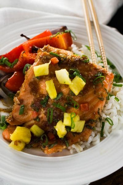 This one pan Teriyaki Salmon flavored with pineapple and ginger is a winning choice for any weeknight dinner! The bold Teriyaki and pineapple flavors make this salmon recipe taste like you have been in the kitchen basting away for hours.
