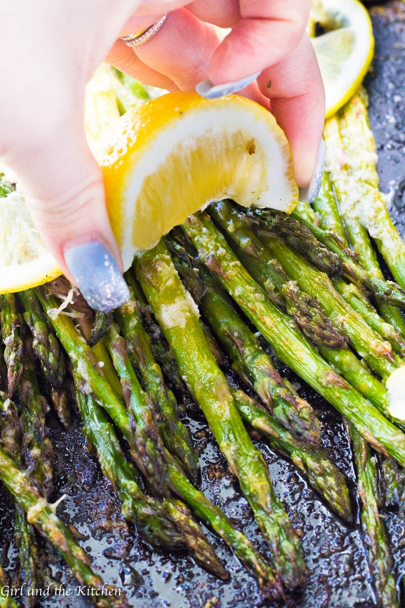 This Lemon Parmesan Asparagus is the perfect side dish for any entree! It is crispy, savory and delicious, best of all it is ideal for a quick and easy weeknight veggie as it comes together in two minutes and and roasts up in only seven minutes!