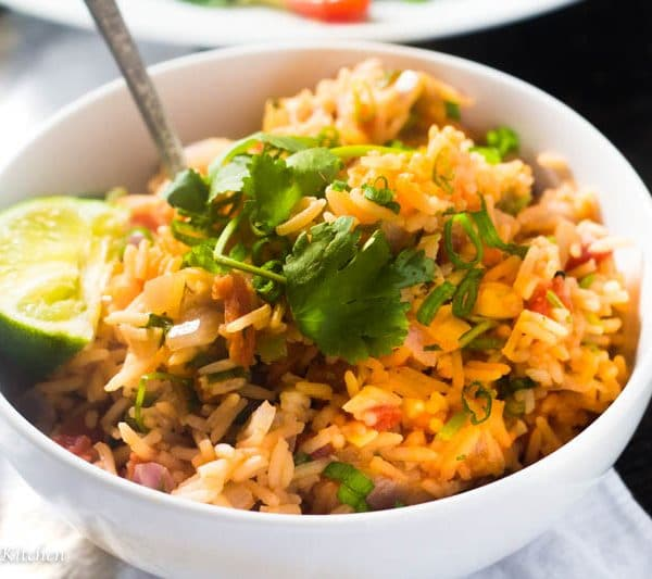 Learn how to make quick and easy Restaurant Style Mexican Rice the healthy way! It tastes just like the restaurant but is made in half the time and with half the fat!
