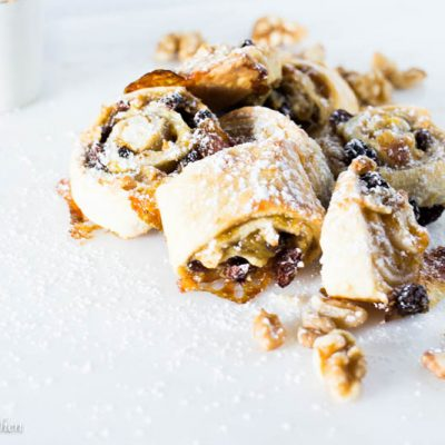 Rugelach are perfect little handheld cooked that are impossible to resist.. Filled with fruits and nuts and rolled up in a delicate cream cheese crust, my rugelach are perfectly sweet and delightfully tender. Trust me on this one, double the batch, your guests will thank you.