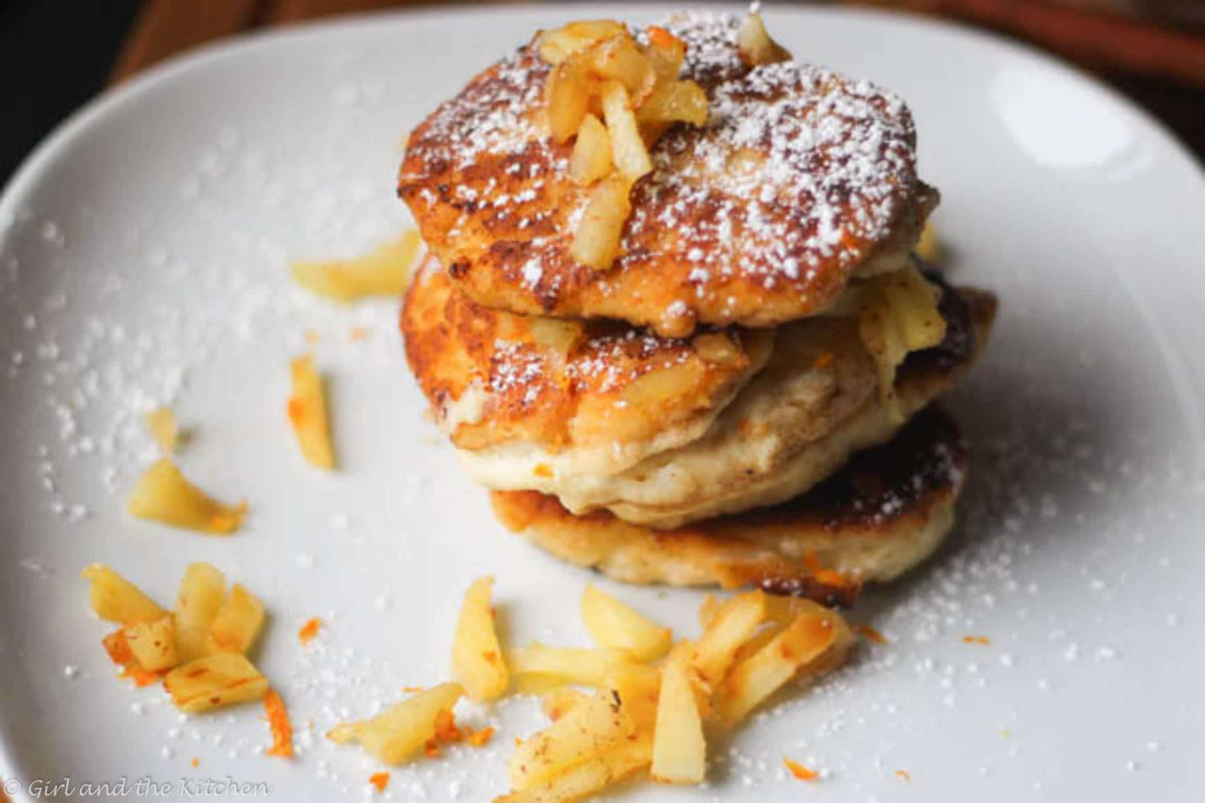 "These plump and delicious ""syrniki"" are Russian cheese and apple fritters that are filling, healthy and creamy.  Perfect for any breakfast, brunch or snack!"