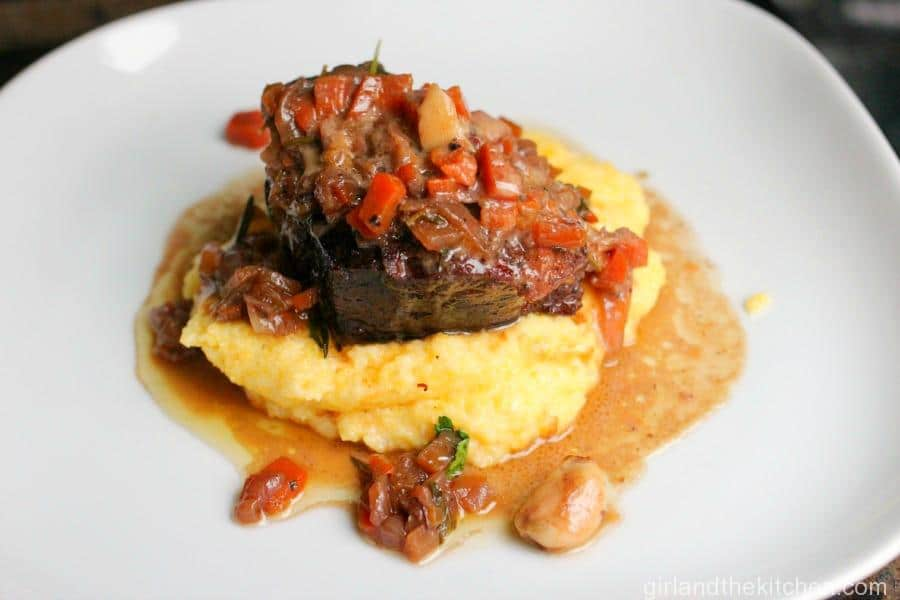 This is comfort food at its finest, tender short ribs rest on top of creamy, dreamy polenta...this is ultimate comfort food gone gourmet.