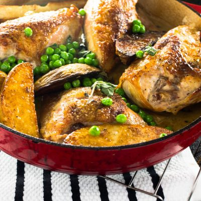 A succulent and garlicky ONE PAN roasted Italian chicken recipe with white wine, fresh herbs and sinfully delicious potatoes to mop up the sauce with! This is ideal for the weekday when there are no plans for the defrosted chicken sitting in the fridge.