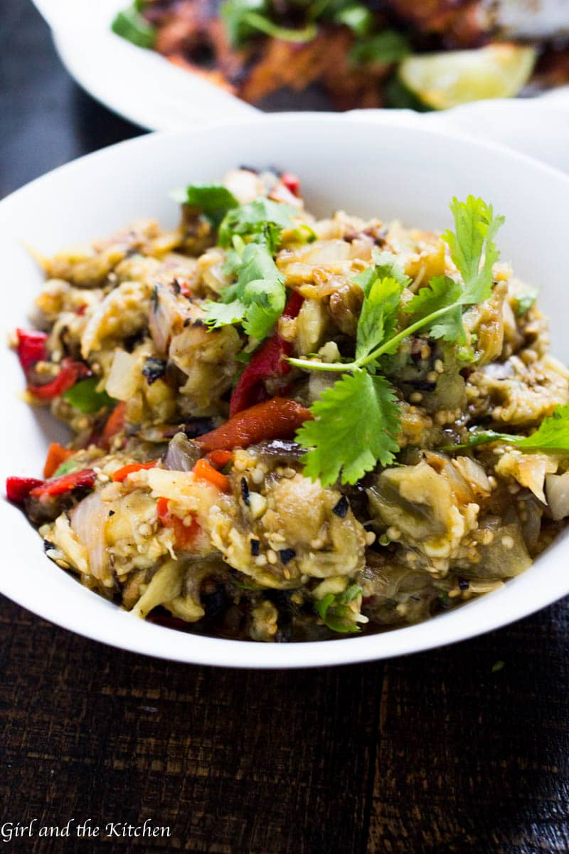 This grilled eggplant salad is full of flavor, light on labor and packed with nutritious and delicious vegetables. The eggplants' mild flavor combined with the vibrant taste of the grilled red peppers, minced garlic and cilantro makes the the ultimate summer salad!