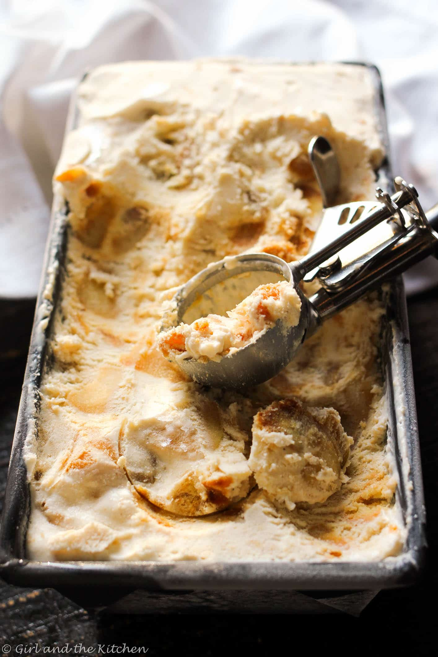 Delicious and creamy no-churn ice cream sweetened with chunks of whiskey soaked caramelized apples and shortbread cookies.