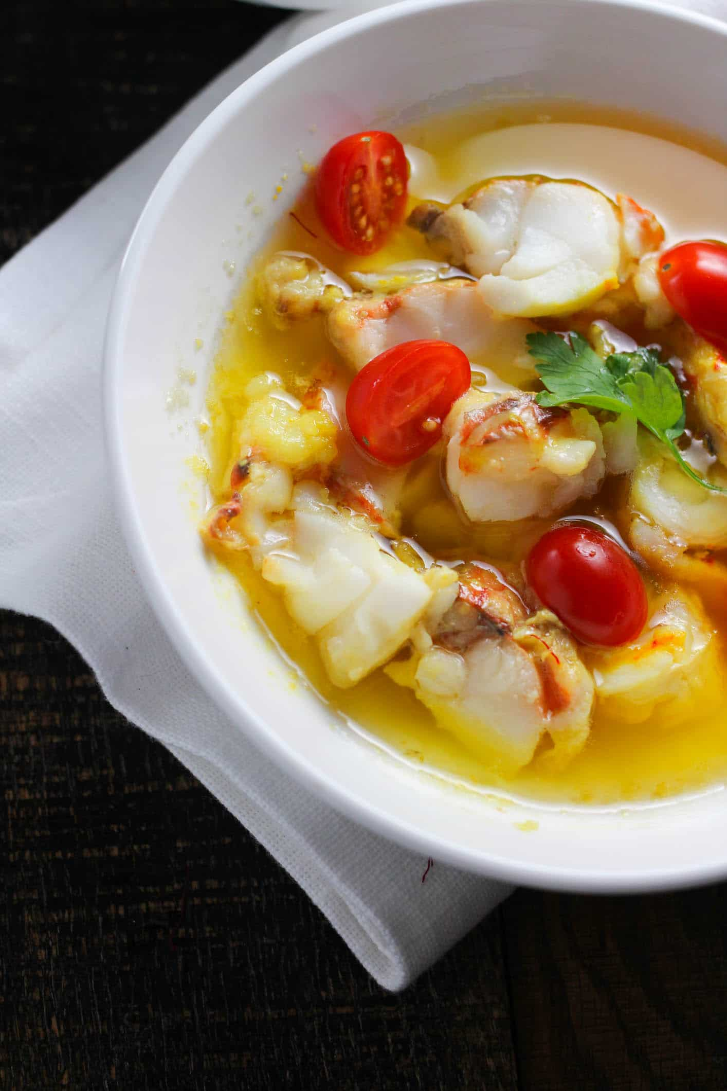 A sinfully elegant butter poached lobster with garlic and herbs is both impressive and ridiculously simple!