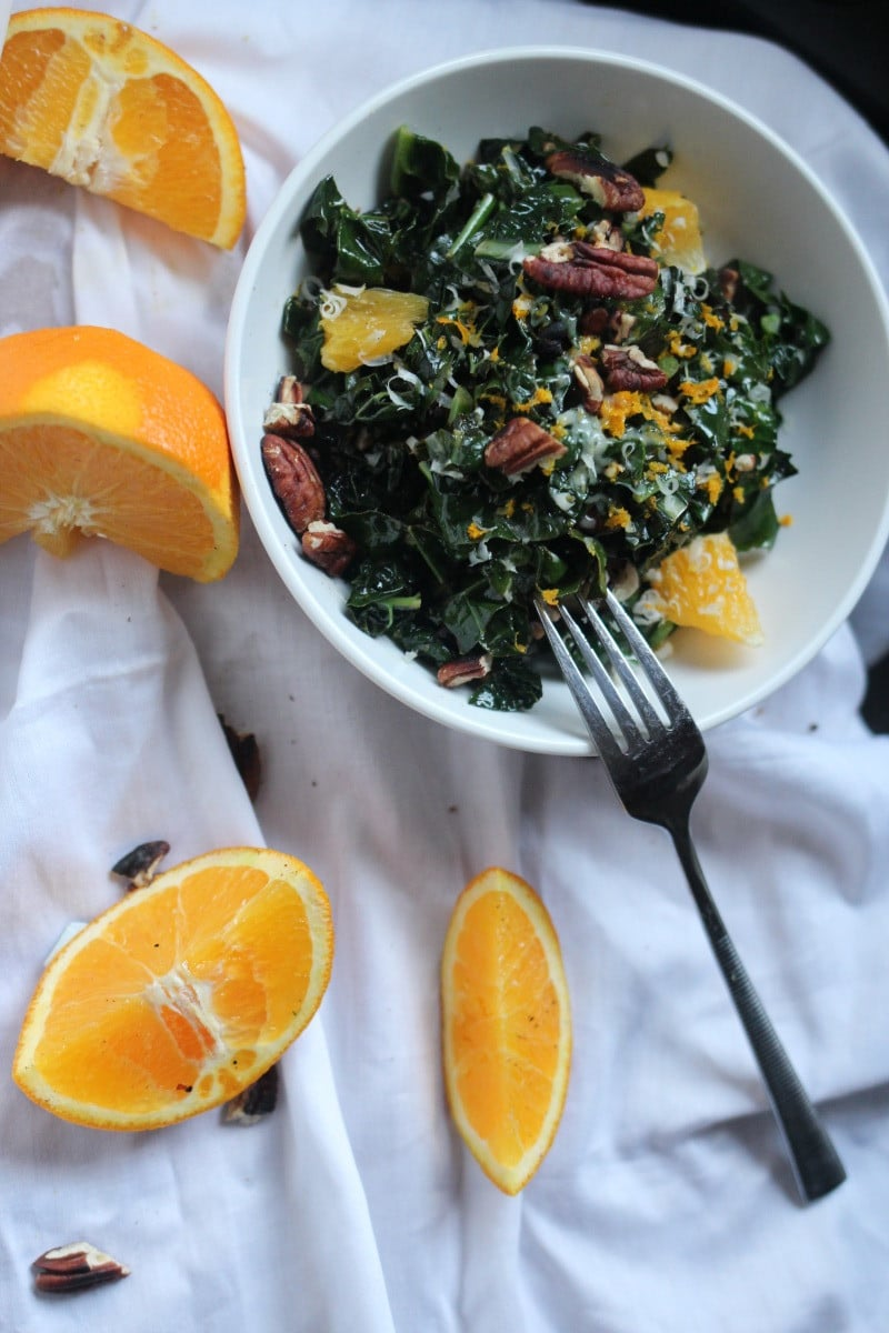 A warm salad with healthy and earthy Tuscan kale and bursting with citrus notes and crunchy pecans. An ideal side dish for a quick lunch when the classic greens are old and played out.