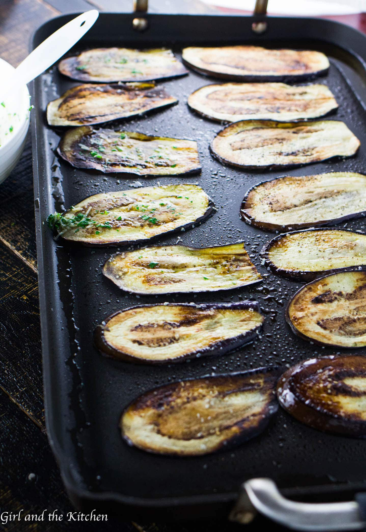 This incredibly easy and delicious eggplant recipe comes together in only 15 minutes! Thinly sliced eggplant is smeared with garlic and herbs after it has been delicately pan fried.