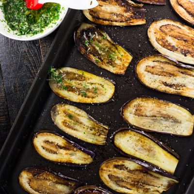 This incredibly easy and delicious eggplant recipe comes together in only 15 minutes! Thinly sliced eggplant is smeared with garlic and herbs after it has been delicately pan fried. q