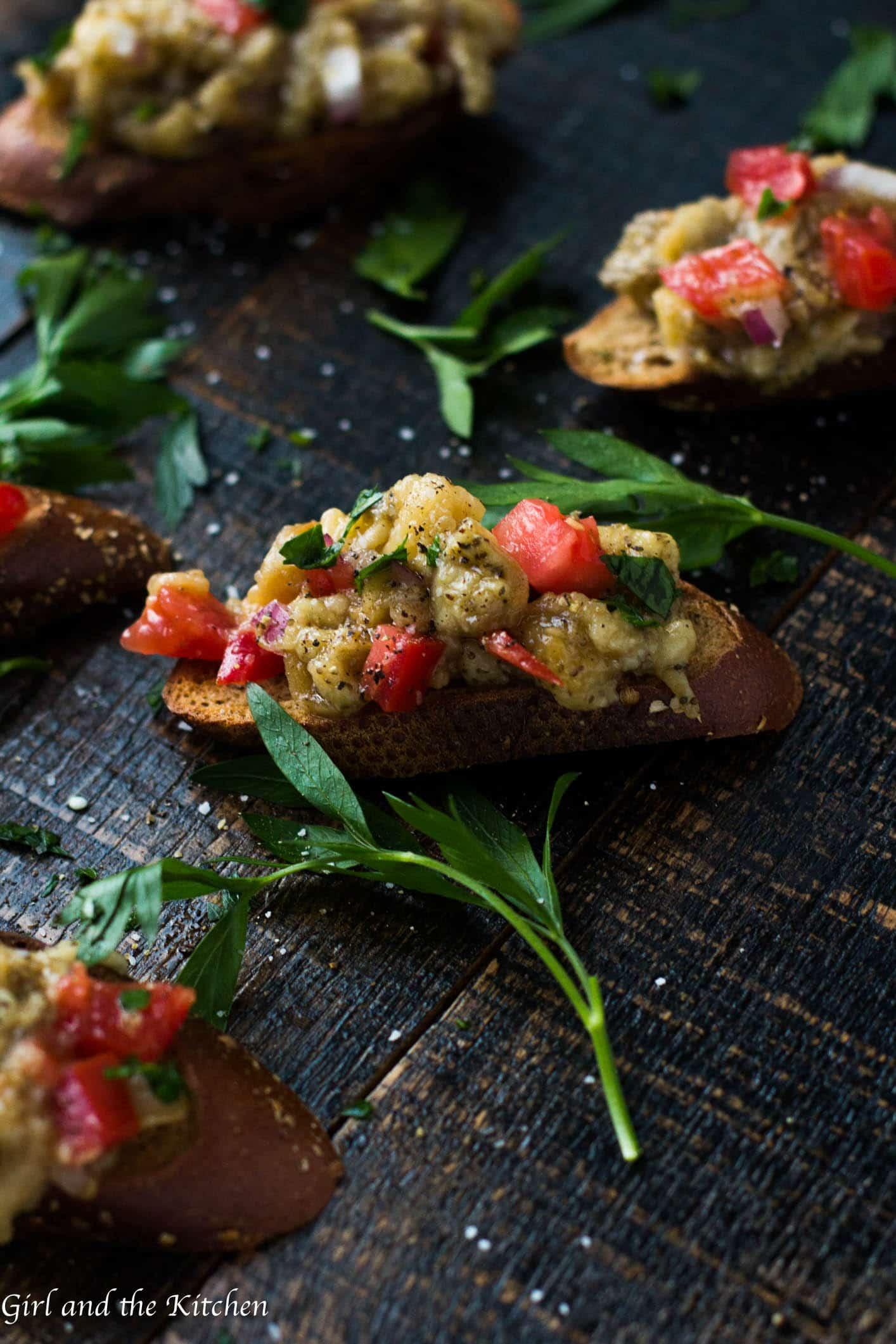 This roasted eggplant salad is a perfect snack or salad for any time! Filled with smoky eggplant and juicy tomatoes, this salad is great spread over some crusty bread or as a side to any meal!