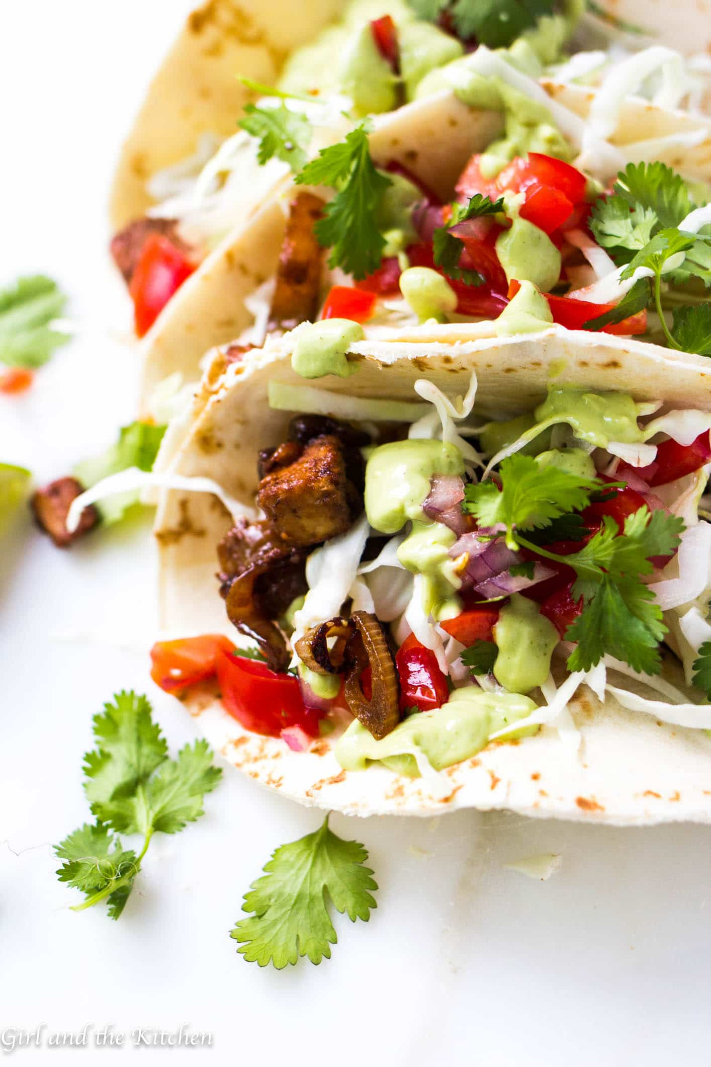 These extremely flavorful and tender tacos made with Quorn Chikn Tenders are perfect for a meatless meal! Loaded with savory and spicy veggies, crispy cabbage and an avocado and cilantro cream this will make any week night seem like a night out in a Mexican taco stand...minus the grease!