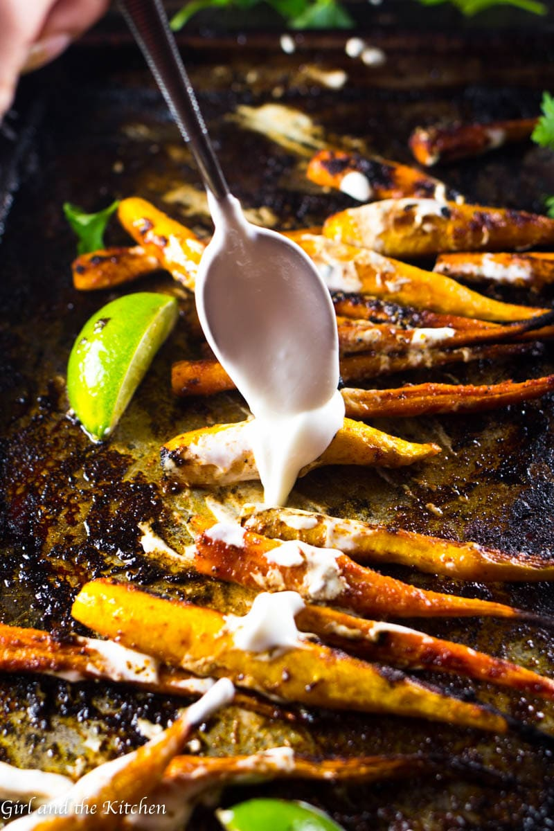 Meet a veggie side dish that will steal the show! Deliciously sweet and spicy roasted carrots with a Moroccan spice blend all drizzled with a creamy and garlicky yogurt!