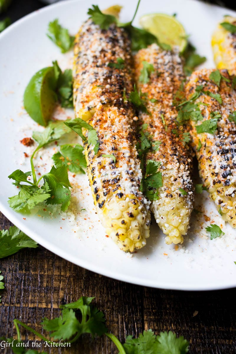 Sweet, tender and spicy! These Mexican Street Corn is all of it! It is full of vibrant colors and bold flavors and will turn your summer BBQ into a fiesta! Of course the best part is how incredibly easy it is to turn regular grilled corn into the show stopper that this Mexican Street Corn is!