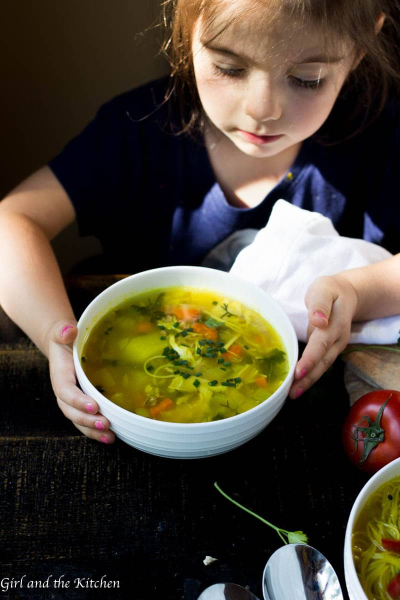 This chicken noodle soup is loaded with good for you veggies and tons of flavor and this bowl of comfort comes together in under 30 minutes. (Pssst check out the little hands in the pic... this is kids approved too!)