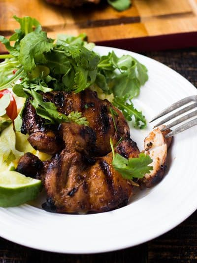 This delicious grilled chicken thighs recipe is perfect for a midweek meal when you need dinner on the table in 30 minutes! The marinade serves as a brine so it infuses the flavor quickly and also acts like a glaze when the chicken is grilling! Easy and fast? Now that's a mid week meal!