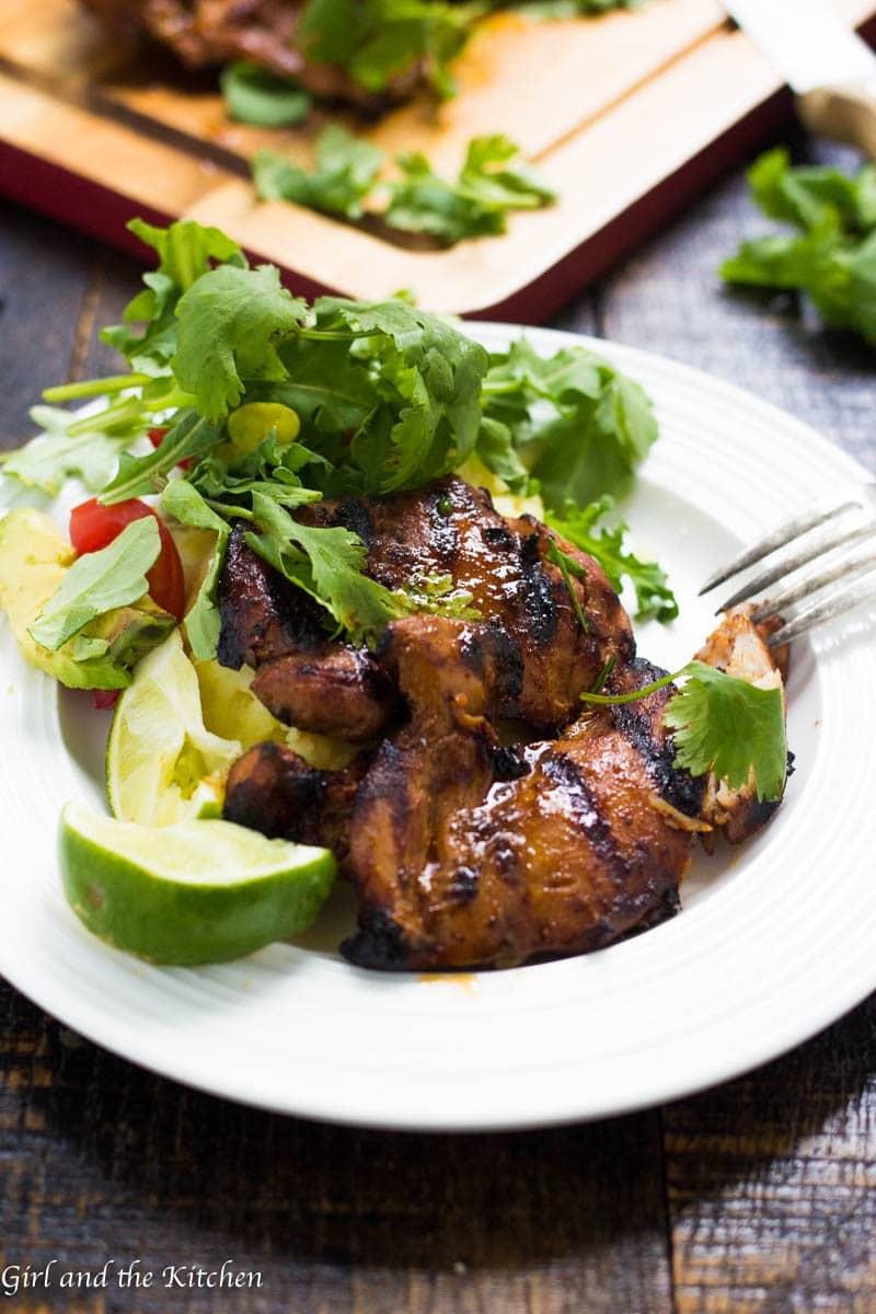 This delicious grilled chicken thigh recipe is perfect for a midweek meal when you need dinner on the table in 30 minutes! The marinade serves as a brine so it infuses the flavor quickly and also acts like a glaze when the chicken is grilling! Easy and fast? Now that's a mid week meal!
