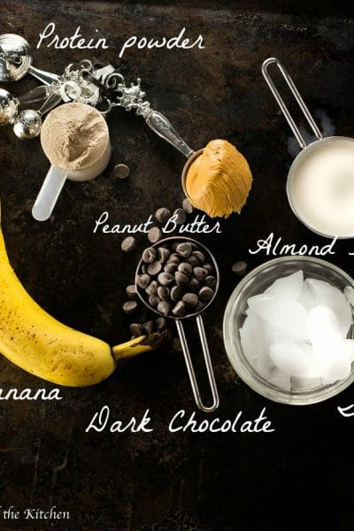 Meet a protein smoothie that tastes like a dessert indulgence! Loaded with dark chocolate, bananas, peanut butter and good for you protein this smoothie will make your muscles and your belly happy!