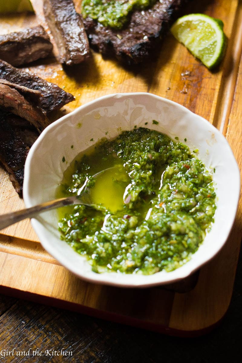 My 5 minute chimichurri sauce has a secret ingredient that sets it apart from the rest! It comes together in just a few minutes with a couple of pulses in the food processor. This sauce packs loads of garlicky flavor and is a perfect sauce, marinade and dip for just about anything!