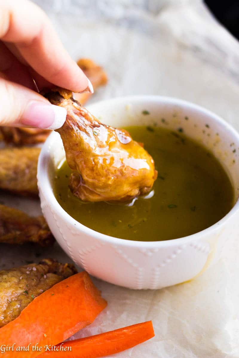 I have discovered how to make seriously CRISPY oven baked chicken wings and they are legit! Perfectly crispy, ridiculously easy and unbelievably tasty! Learn the trick that makes them crisp up in the oven with no effort and allows for most of the fat to drip right off. Leaving you feeling less guilty to dip away in my savory garlic butter sauce.