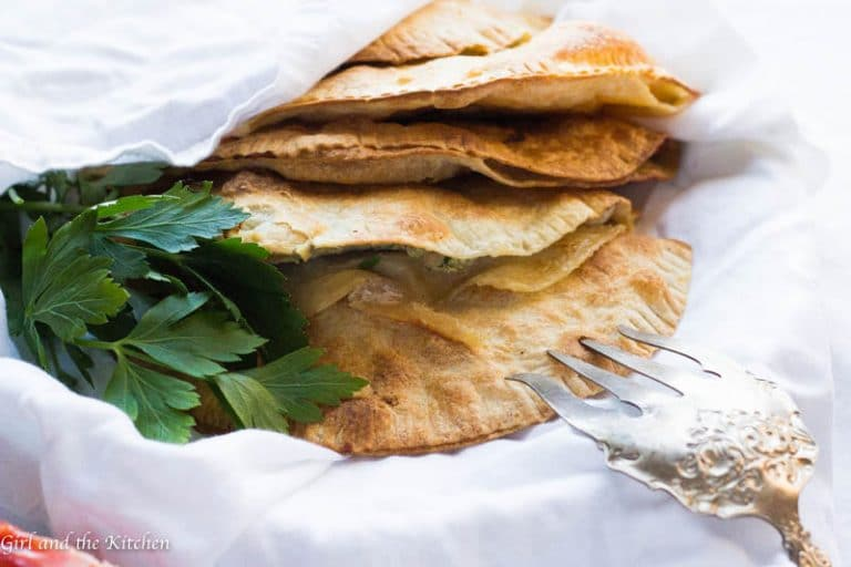 Chebureki are traditional Russian meat pies that are more similar to little meat turnovers than anything else. Traditionally made with a from-scratch dough and deep fried these babies can be both difficult and loaded with fat. My recipe features a no fry method and dough that is store-bought without sacrificing any flavor!!!