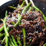 Meet an exciting twist on an ordinary vegetable. These Honey Soy Glazed Green Beans are packed with flavor and tossed in a gorgeous honey glaze that sticks to every delicious side! The addition of woodsy shiitake mushrooms only adds to the deliciousness of this side!