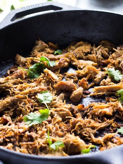 This Instant Pot Pulled Pork makes for the ultimate carnitas!!! Loaded with just the right flavors and ridiculously simple this is the only Mexican pulled pork recipe you will ever need, plus learn how to get gloriously crispy bits that are perfect in tacos!