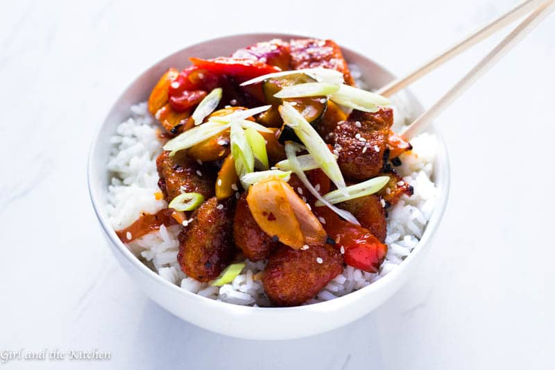 A super delicious and simple vegetarian baked sweet and sour chicken recipe that is sure to please even the biggest meat eaters! Best of all it is loaded with tons of healthy and crunchy roasted vegetables and no frying is necessary!