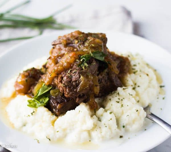 This ridiculously tender Instant Pot Pot Roast is made with only 3 ingredients but is loaded with flavor! Tender meat is surrounded by a luxurious sauce! Perfect for a Sunday dinner but easy and fast enough for Monday nights!
