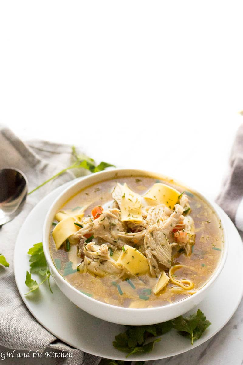 Learn how to make instant pot chicken soup with this delicious guide!  The recipe is absurdly simple yet  filled with loads of hearty flavor all with the added bonus of a one pot meal!