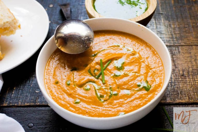This creamy roasted tomato soup is ready in 30 minutes and is everything thatcomfort food needs to be! Roasting the vegetables cuts down on time but amps up the flavor! The soup is creamy without being overly heavy and the incredible chive oil adds a dimension of flavor that makes this better than restaurant soups!