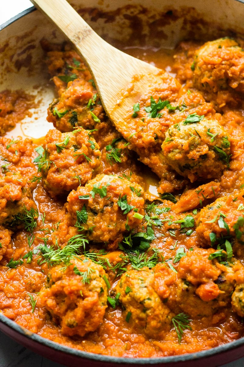"Learn how to make porcupine meatballs, the most tender and savory meatballs I have made yet!  They are full of delicious fresh herbs and cooked in a savory and creamy tomato sauce that can be licked with a spoon!  Plus learn the very fun reason why they are called ""porcupine"" meatballs!"