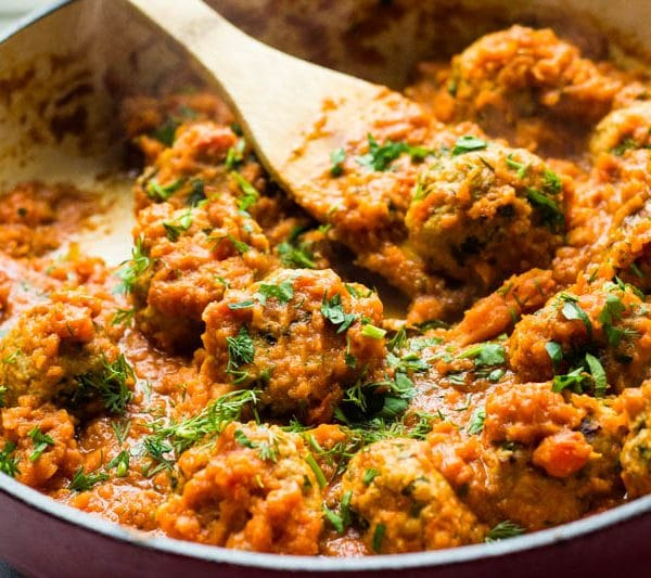 """Learn how to make porcupine meatballs, the most tender and savory meatballs I have made yet! They are full of delicious fresh herbs and cooked in a savory and creamy tomato sauce that can be licked with a spoon! Plus learn the very fun reason why they are called """"porcupine"""" meatballs!"""