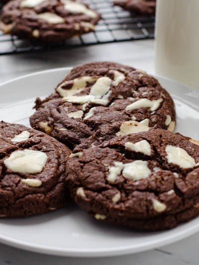 These Double Chocolate Chip Cookies are the gooiest most chocolaty cookies ever!!! Filled with white chocolate chunks! These double chocolate chip cookies are the ultimate cookie for ANYONE!