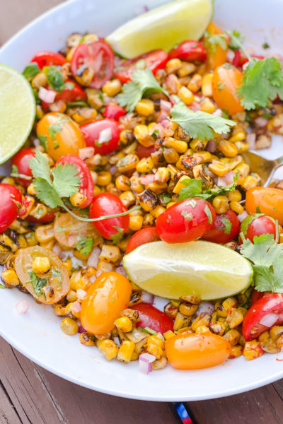 corn and tomatoes and lime in a bowl