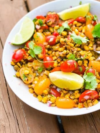 corn, tomatoes and lime in a bowl