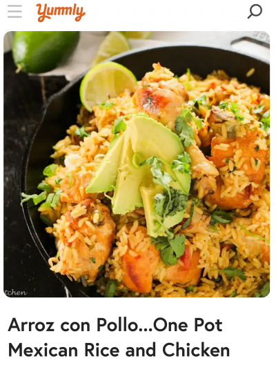 Yummly arroz con pollo recipe with picture of rice and chicken on a dark plate with limes and avocado
